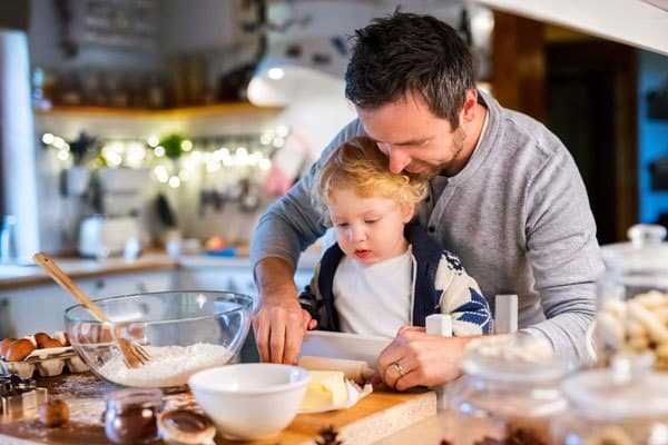 Dad and toddler baking on Christmas Eve