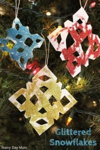 Easy Christmas Craft for Kids to create Simple Glitter Snowflakes inspired by the ones in Merry Christmas Mouse! Quick Craft to do on a Rainy Christmas Day
