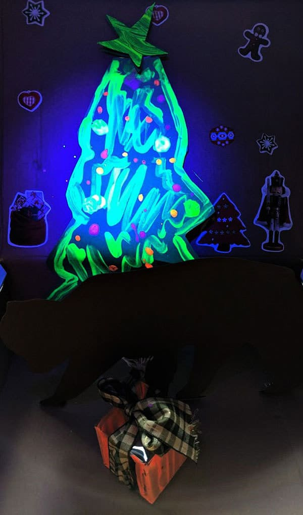 Decorated with glow in the dark paint . A fun Chrstmas STEAM Project for kids to do