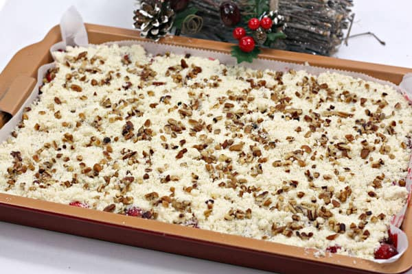 chopped pecans on top of a crumble topping for a nutty flavour to the cake bars