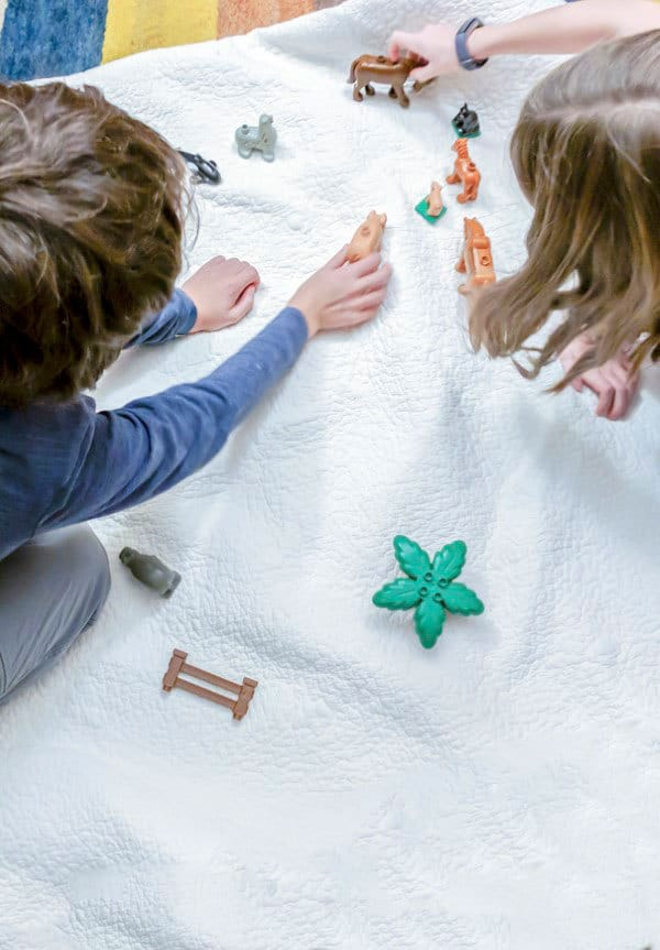 kids playing with a snowy small world activity