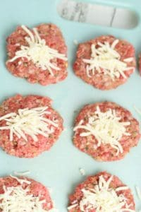 making meatballs stuffed with grated mozzarella cheese