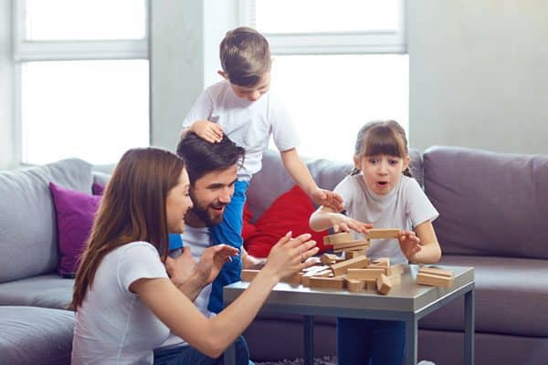 spend time as a family playing board games in the winter indoors