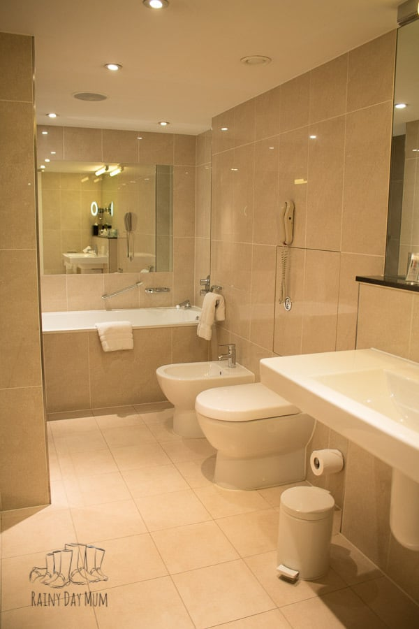 bathroom in executive suite room in Royal Garden Hotel London