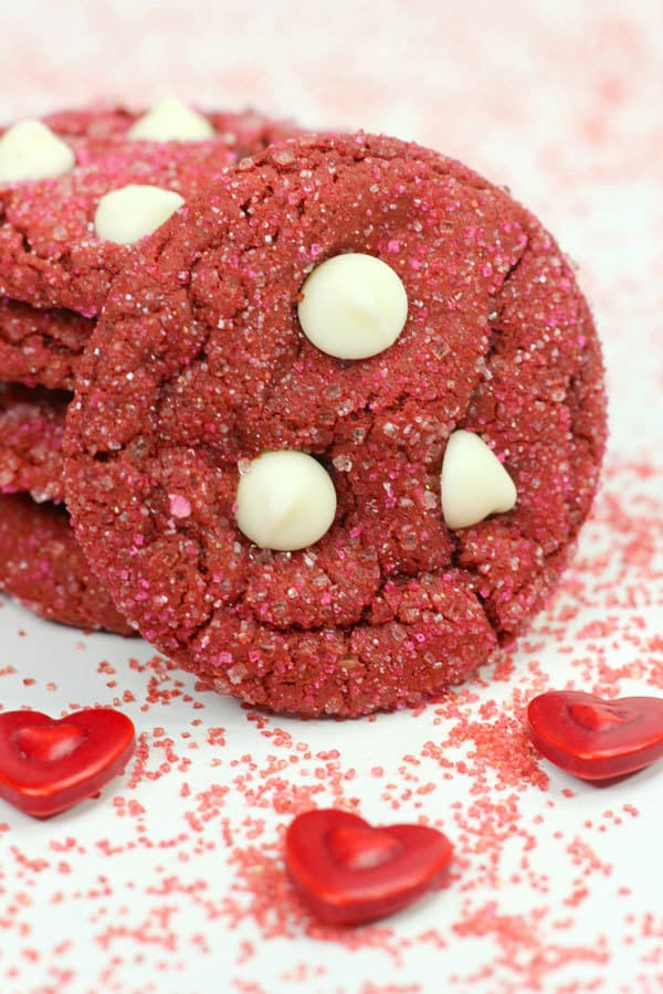 valentine recipe for red velvet cookies with white chocolate chips and sparkles a simple recipe that is easy to make with the kids