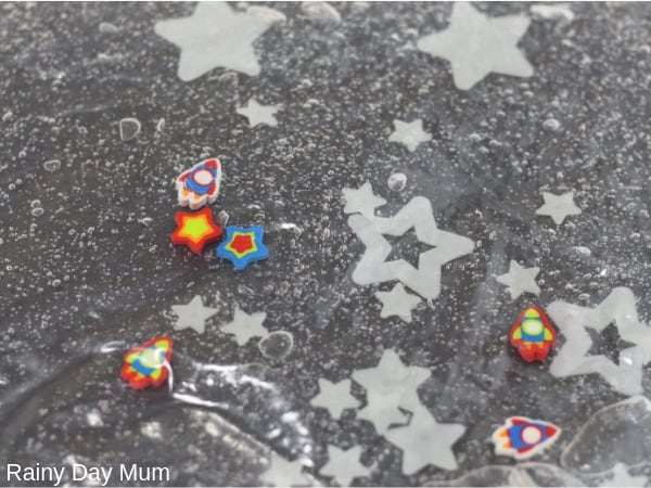 space erasers and glow in the dark stars in a simple sensory bag for toddlers and preschoolers