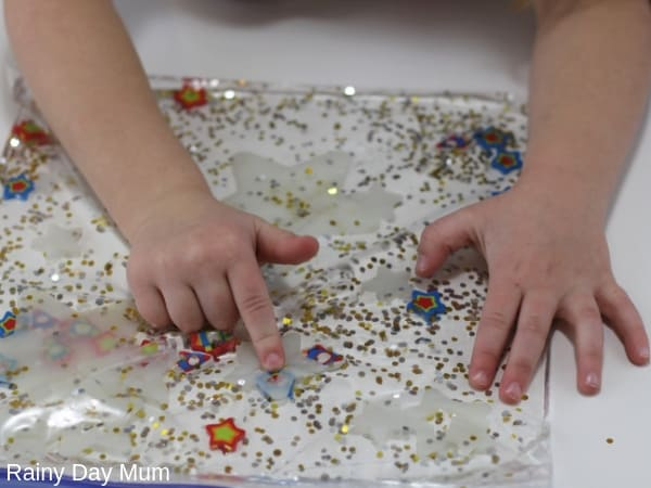 preschooler counting stars in this simple space theme sensory bag