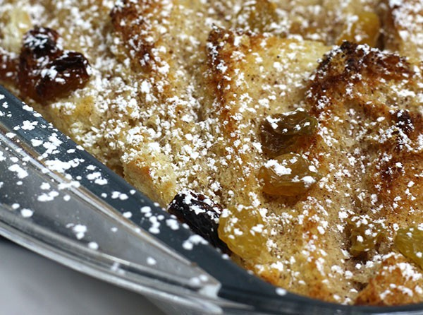 close up of the layers of bread and raisins in a traditional bread and butter pudding for family meals