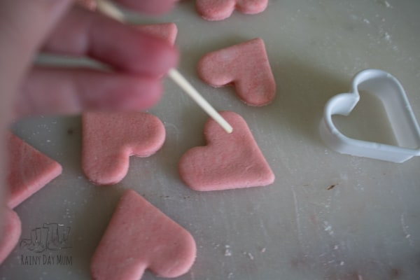 turning salt dough hearts into threadable beads or buttons for activities with preschoolers