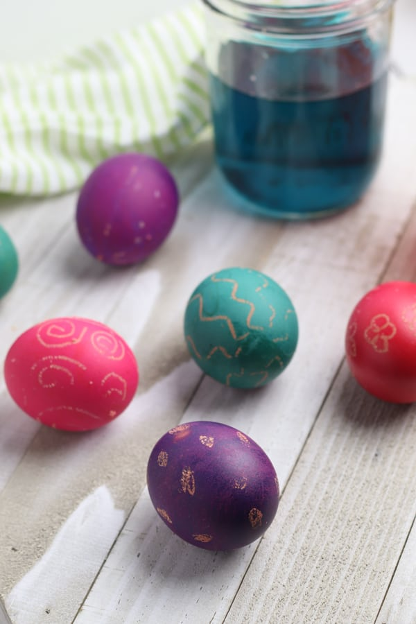 dyed easter eggs with wax resist decorations on that are so simple you can make with toddlers