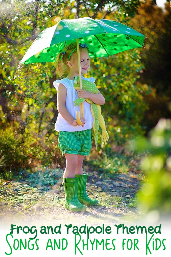 girl holding a frog under an umbrella for a set of frog and tadpole rhymes and songs for kids