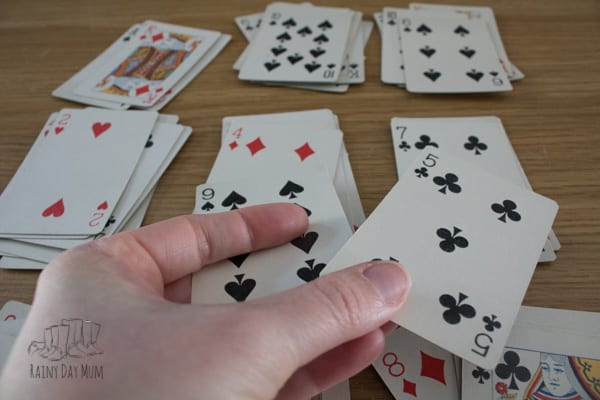kid placing cards down in a game of elevens