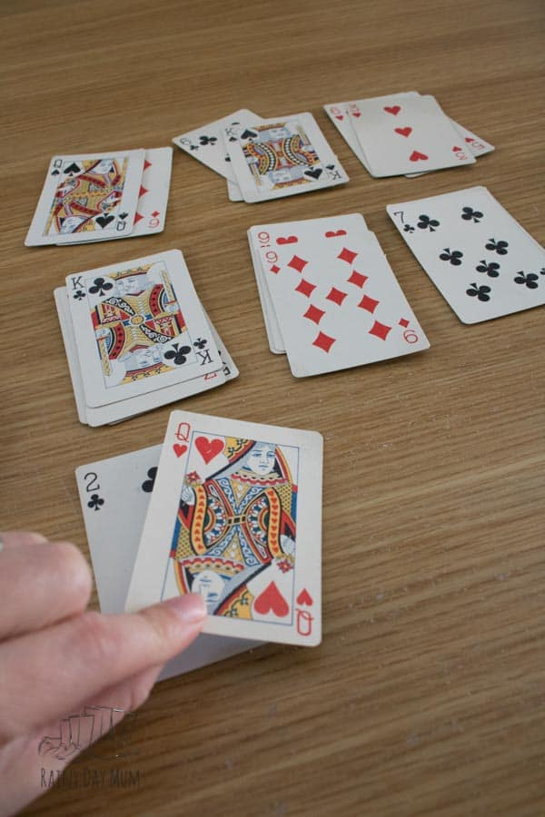 setting up the deck for a game of elevens solitaire for kids