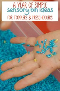 Child's hand in a rice filled sensory bin