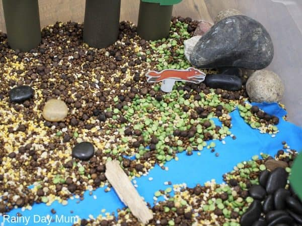 A fox log pile house in sensory bin inspired by the Gruffalo for toddlers and preschoolers