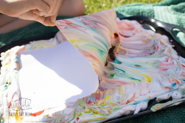 removing the paper from shaving foam marbling to reveal the image