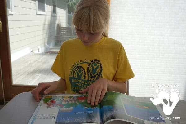 Child reading a non-fiction book about space