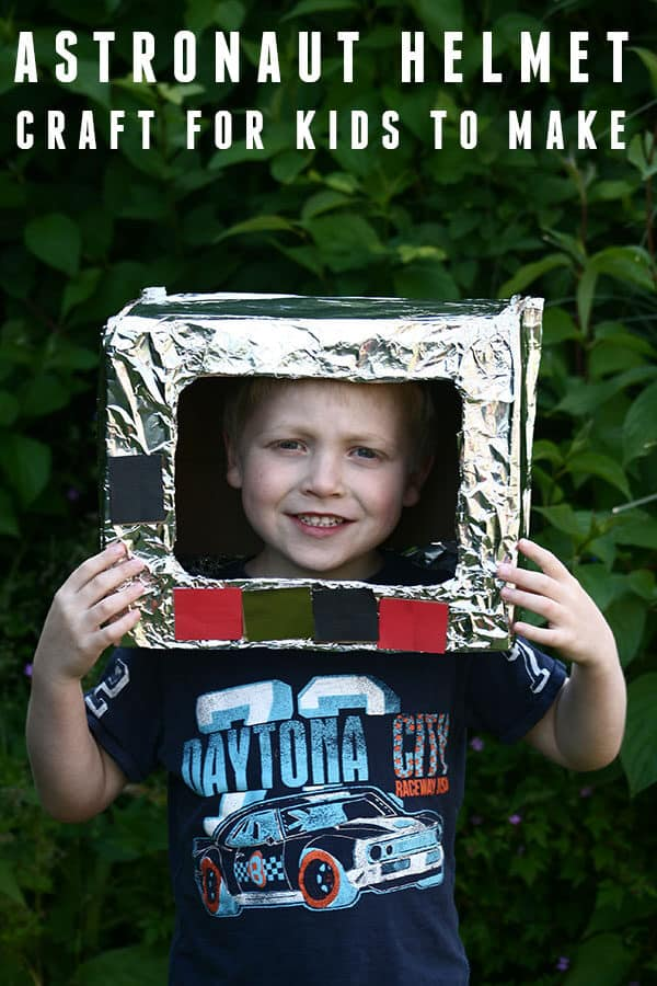 Child wearing a junk model Space Helmet they have made at home and used for imaginative play