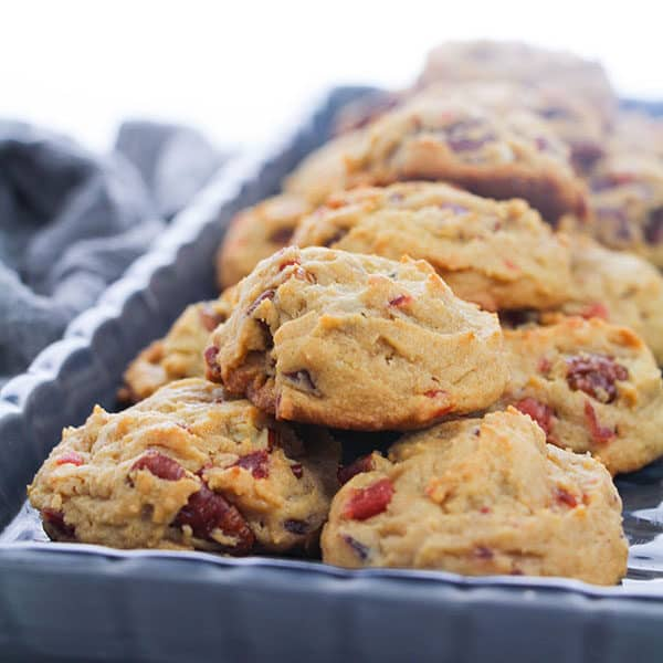 cherry and pecan cookies on a grey baking tray