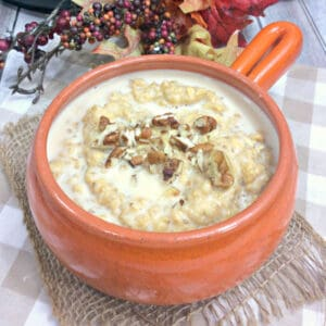 pumpkin, maple syrup and chopped pecan porridge in a rustic bowl