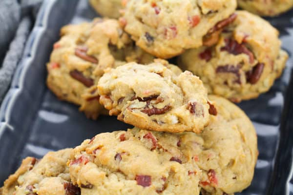 soft and chewy fruitcake cookies on a grey tray