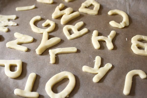 alphabet cookies on a baking tray