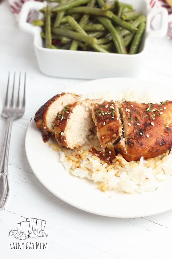 slow cooker brown sugar and garlic chicken breasts served with rice and a side of green beans.