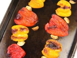 roasted red and yellow bell peppers with garlic cloves