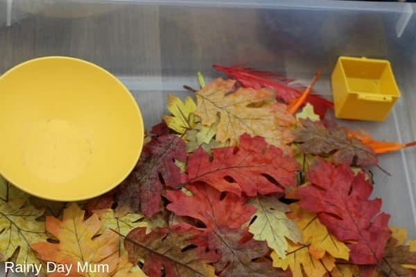 using silk leaves to hide objects in the sensory tub
