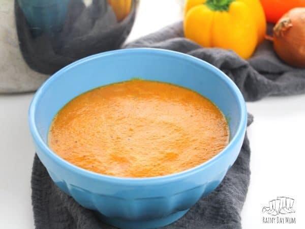 sweet pepper soup in a blue bowl ready to be eatten