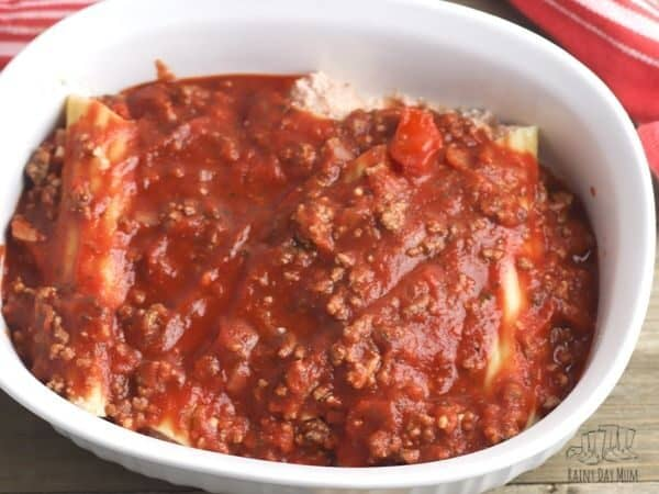 stuffed cannelloni in a baking dish without cheese on top