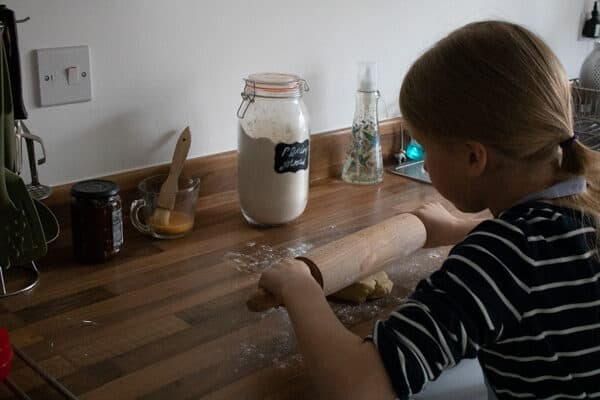 child rolling pastry