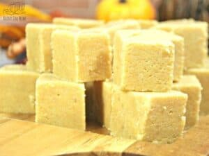 close up of 1inch square of pumpkin and white chocolate fudge