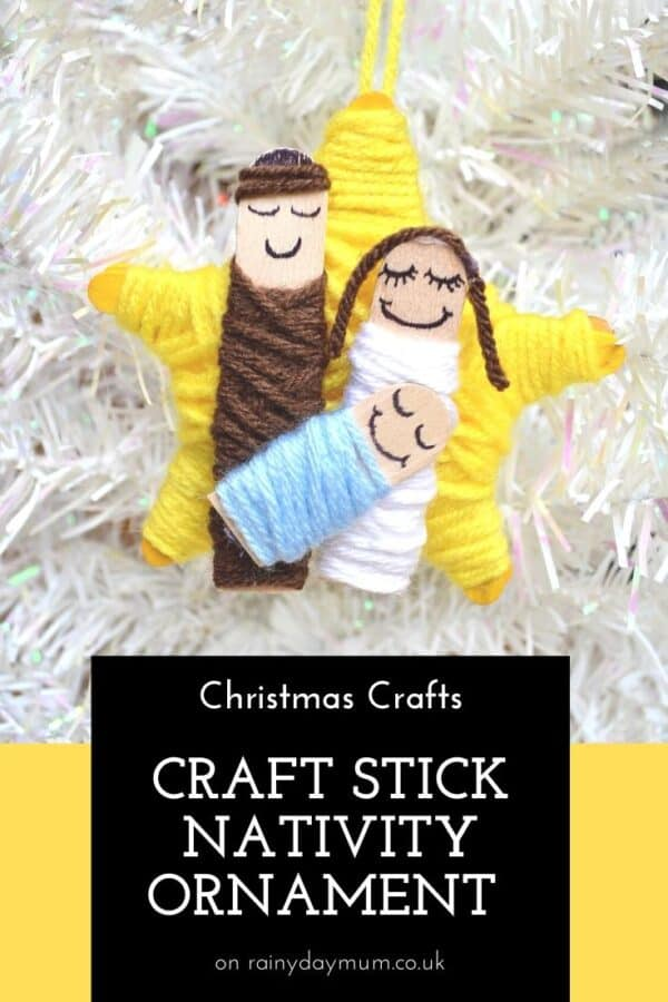 Craft Stick Nativity Ornament on a white Christmas Tree