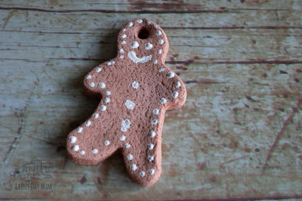 simple decoration on coloured salt dough gingerbread men ornaments