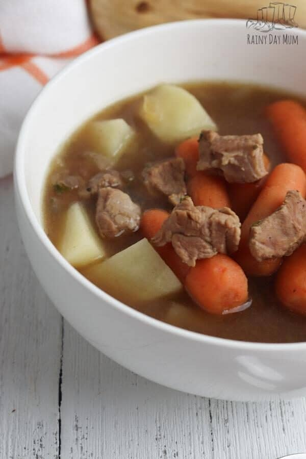 slow cooker lamb stew in a white bowl