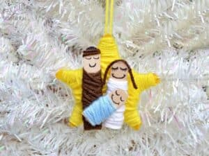 simple nativity ornament craft to make with craft sticks and yarn
