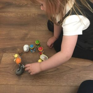 Preschooler playing a Nativity version of the memory activity Kim's Game