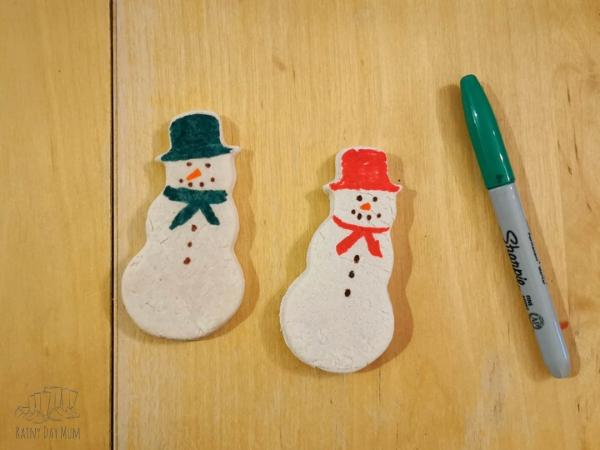 finished salt dough snowmen decorated with sharpies