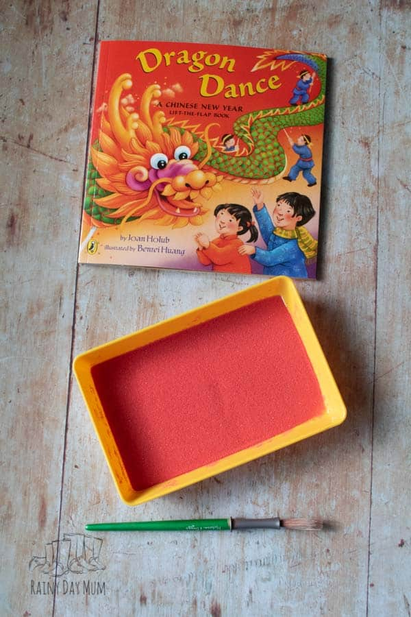 Materials for your sand writing tray on a Chinese New Year theme