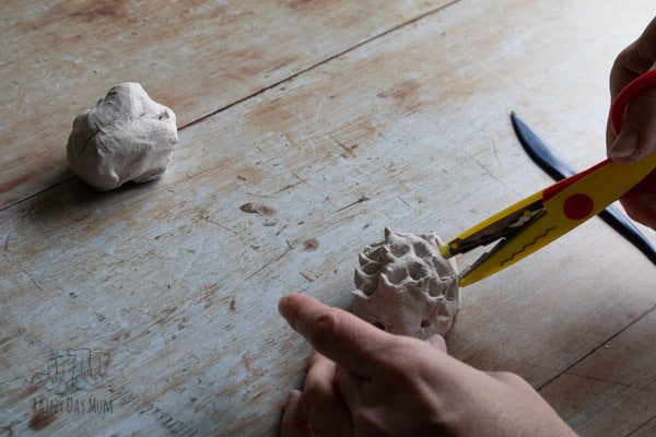 cutting spikes in the clay - a simple cutting practice craft for kids