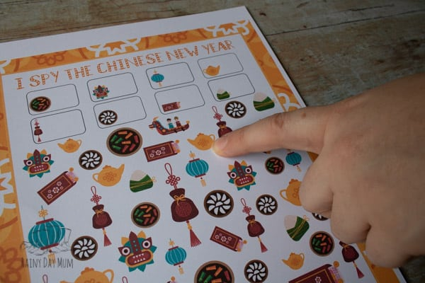 playing the free printable chinese new year activity with preschoolers