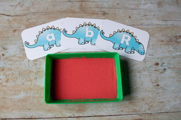 dinosaur sand tray invitation to write and mark make