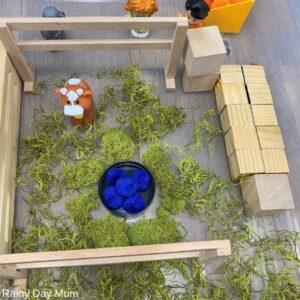 farm animals in sensory bin