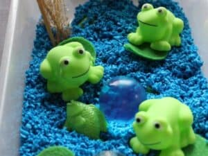 five little speckled frog sensory bin for toddlers and preschoolers