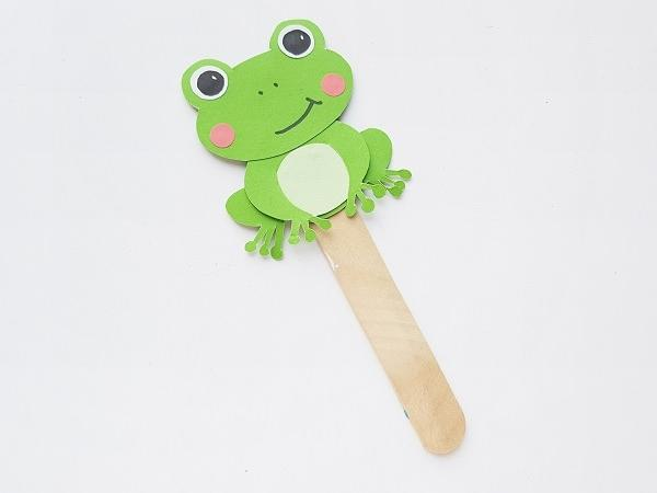 frog paper puppet assembled using the template