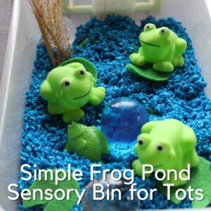 frog pond sensory bin with plastic frogs, aquarium gravel and giant water beads set up for sensory play for a spring theme with toddlers and preschoolers