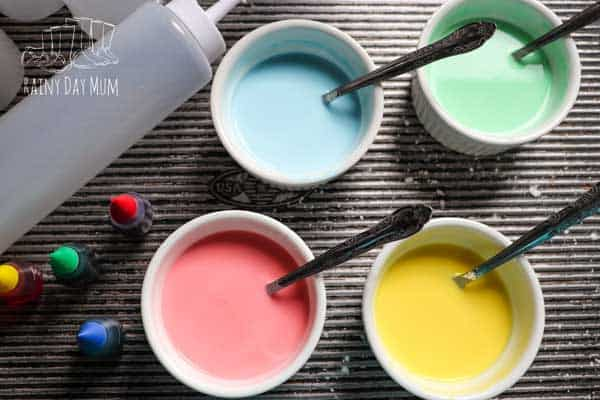 bowls with sidewalk chalk in ready for kids to paint with