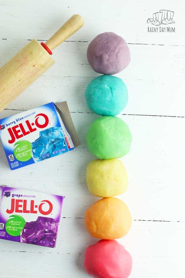 coloured playdough madde at home with Jell-o on a white background