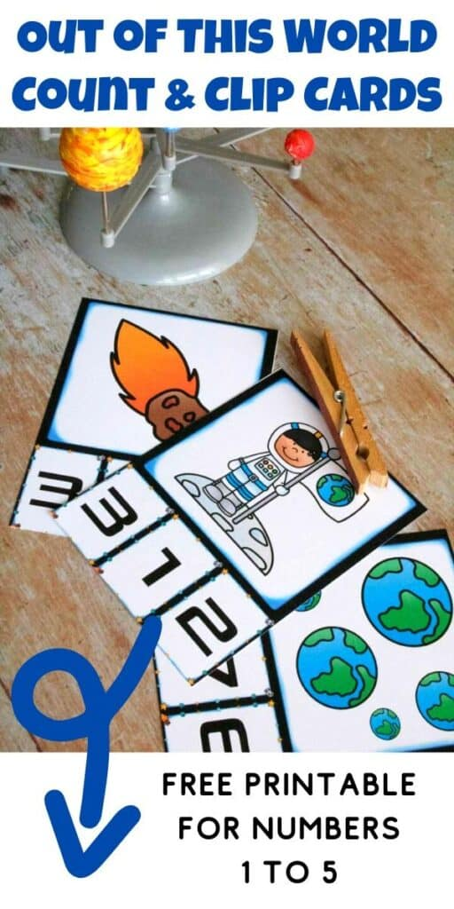 Space counting cards on a wooden table with text reading Out of this world count and clip cards free printable for numbers 1 to 5